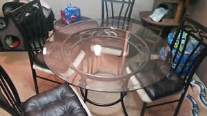 Glass dining room table and matching chairs