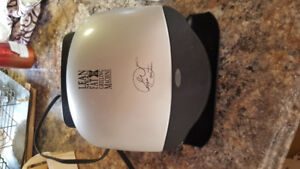 George Forman fat reducing grilling machine