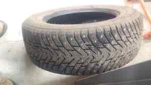 Like new Nokian studded tires 215/60R16