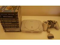 Ps1 with 10 games and controller.