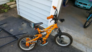 Boys 14 inch bike with helmet $30