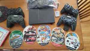 PS2 with 4 controllers, memory card & games