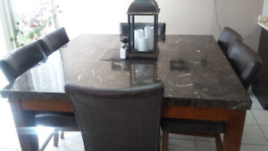 Marble dinning table with eight chairs
