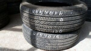 Pair of 2 Bridgestone Dueler HL422 215/70R16 tires (50% tread li