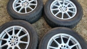 """Set of 4-225/60/16"""" Tires on Universal fit rims(Like New)"""