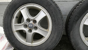 4 16in hyundai rims with Xice winter tires on them