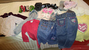 Bin of Baby Girl Clothes