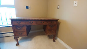Antique office desk with claw feet and classic details.