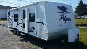 2009 Pilgrim 28 foot trailer with slide and bunks.