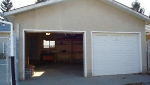 Double car garage including utilities