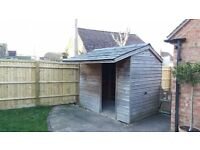 SHED with slate tiled apex roof. Sturdy and in very good condition.