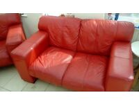 Red soft leather sofas