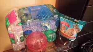 Hamster cage, food and paper beding