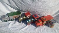 SET OF FOUR VINTAGE CHRISTMAS TIN TRUCKS AND TRAINS