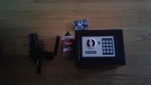 Safe with key and numbsr lock and co2 handgun with 6000 copper
