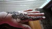 Henna mehandi art on the hands.$5 only per side.