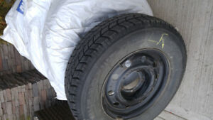 Four 15 inch Rims for Geo Tracker with tires