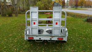 """Lawn trailer 6'2"""" long by 4' 2"""" wide 1 year old ."""