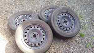 15 inch 4 bolt steel rims with tires..only $80 for all