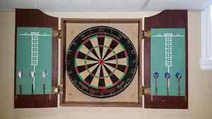 Dart board with wall cabinet