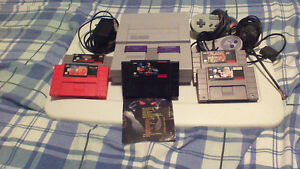 SNES (2 controls, 5 games, adapter, rf switch) excellent cond.
