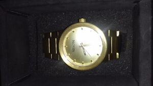10Kt Gold Necklace & Gold Nixon Watch