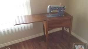'Domestic', Sewing machine with hardwood folding cabinet