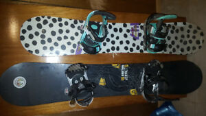 2 burton boards with boots