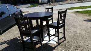 dining table and four chairs brown colour