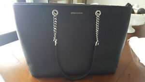 Brand new black Michael kors purse with silver hardware.
