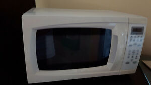 White microwave oven with turntable