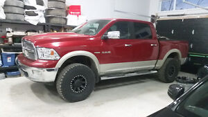 2010 Dodge Ram Laramie crew hemi lifted lots of new parts.