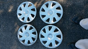 Four (4) 2002 Toyota Corolla hubcaps 175/65R14