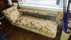 antique chaise lounge or fishermans couch