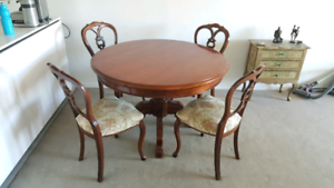 Round wooden pedestal table and four chairs