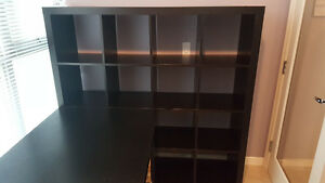 Black shelving unit with attached table