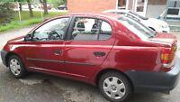 Toyota Echo 2004 rouge manuelle propre et très bon état+pneus
