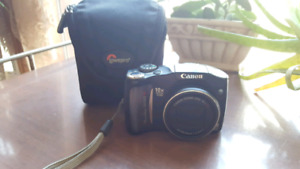 Canon PowerShot SX100 IS with case