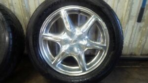 "Set of 4, Chrome 16"" Oldsmoble rims with tires"