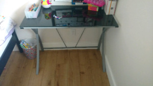 Glass desk with a pink chair for sale