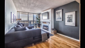 Large Modern Charcoal Grey Sectional With A Large Attoman