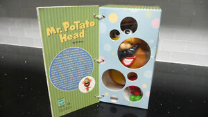 50 YEARS of MR. POTATO HEAD Collectible**Toy with book attached*