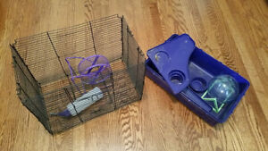 Hamster or gerbil Cage with two wheels and water bottle.