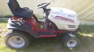 White Outdoor riding mower/ lawn tractor