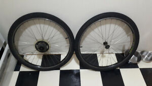 2 clean full bicycle wheels with tires