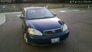 MUST SALE TOYOTA COROLLA. OWNER LEAVING
