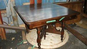 Antique extenion table and 4 cane bottom press basck chairs