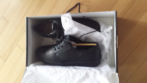 Brand new size 9 black man shoes. Original price was $70 you can
