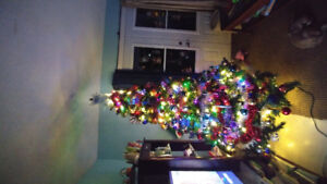 6ft Christmas tree pre lite with extra lights.