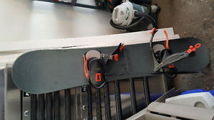 5 foot Liquid snowboard, Elan bindings